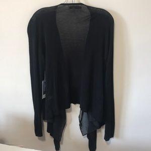 Jennifer Lopez black open sweater. Size large.